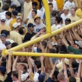 Students take goalposts after football victory