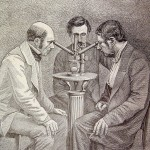 Men looking through microscope