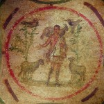 Christ as the Good Shepherd (1st-3rd cent. AD), from the Catacomb of St. Priscilla in Rome (Click to enlarge.  Click a second time to enlarge further.)