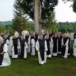 No, this isn't the choir.  But these are, in fact, Trappist monks.  They don't really take a vow of silence -- but idle talk is against their monastic rule, so it often seems as if they have.