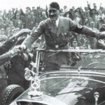 "12 March 1938: Adolf Hitler arrives triumphantly in Vienna following his successful ""Anschluss"" of Austria"
