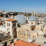 The two gray domes of the Church of the Holy Sepulcher in the densely crowded Old City of Jerusalem