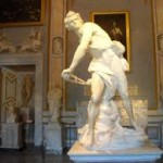 Bernini's David, showing him as he's just about the sling his stone at Goliath.  There's a look of fierce concentration on his face, which is a Bernini self-portrait.  (If you can't see it, find a larger photo online somewhere.)