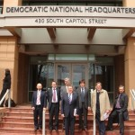 Several Fox News operatives -- predictably, middle-aged white males, all of them -- standing in front of the offices of one of Fox's front organizations in Washington DC