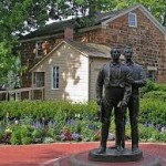A statue of Joseph and Hyrum Smith now stands in front of the Carthage Jail in Illinois, where they were murdered on 27 June 1844.