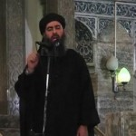 """A man purported to be the previously secretive """"Abu Bakr al-Baghdani"""" (but now to be known as """"Caliph Ibrahim"""") speaking recently from the pulpit of a mosque in Mosul, Iraq"""