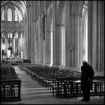 an old man in an otherwise empty church