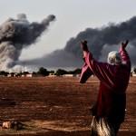 At Kobani, with bombs