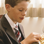Young man partaking of the sacrament