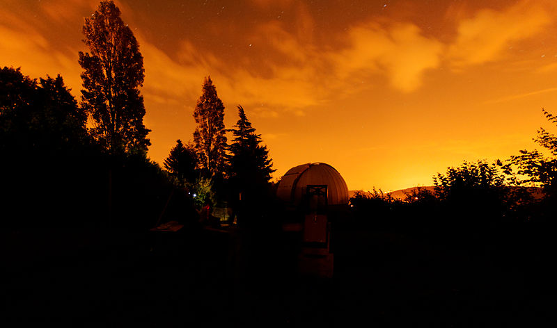 Sunset over an astronomical observatory