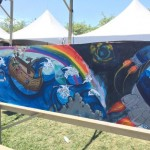 Artists paint anti-Ark Encounter mural at Kentucky festival