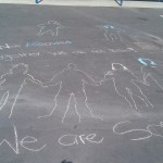 Photo I took on a middle school yard in Oakland. The kids were doing an expressive art project after watching the movie Bully as an entire school. They came up with the idea of drawing their shadows connected together, in respect.