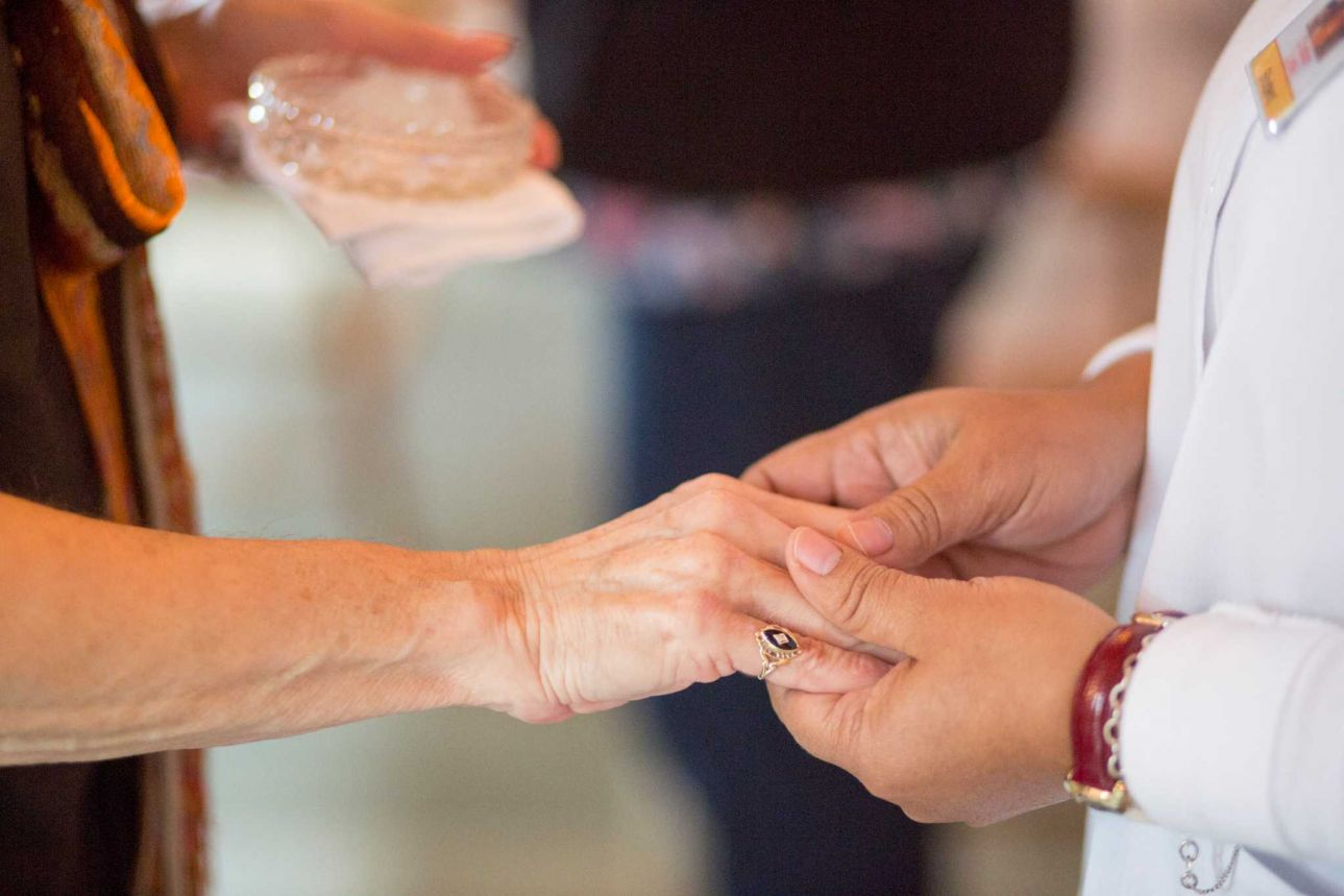 Blessing the hands of hospice workers