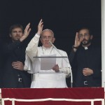 Pope Francis, two newly ordained priests give blessing during 'Regina Coeli' at Vatican