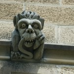 gargoyle eating snake