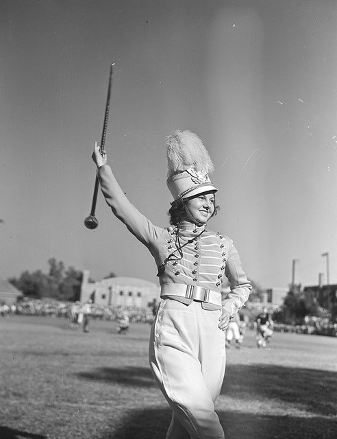 """Drum majorette (Tyler)""; Photo credit: DeGolyer Library, Southern Methodist University. https://www.flickr.com/photos/smu_cul_digitalcollections/ No known copyright restrictions."