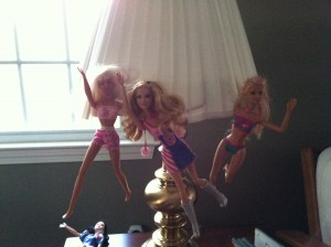 The Barbies in our house get a little crazy sometimes. Note poor Snow White, who apparently lost her grip and plummeted from the lamp shade.