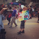 Bec walks with others in the ATL pride march