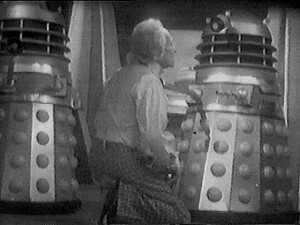 The Doctor kneeling near Daleks