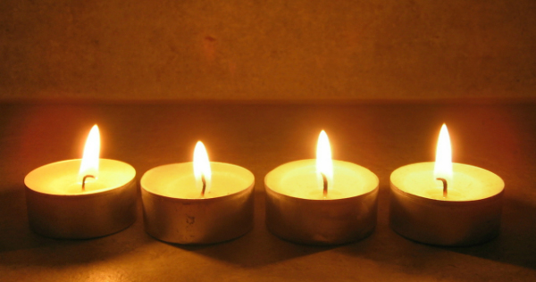 four tea light candles in a row symbolize healing