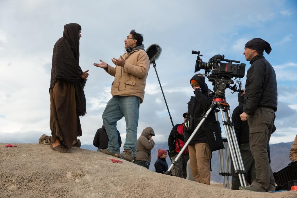 "FRANÇOIS DUHAMEL/BROAD GREEN PICTURES Ewan McGregor, as Yeshua, chats with director Rodrigo Garcia on set for ""Last Days in the Desert,"" shot by acclaimed cinematographer Emmanuel Lubezki (far right)."