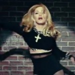 Madonna Sports Cross In New Video, World Yawns