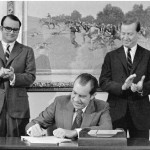 President Nixon signing the Clean Air Act on Dec. 31, 1970, flanked by his environmental dynamic duo of Bill Ruckelshaus (left) and Russell Train.