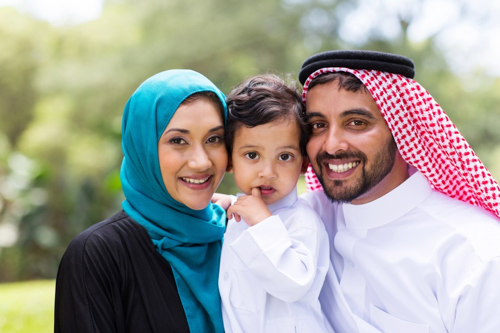 young Arabian family portrait outdoors