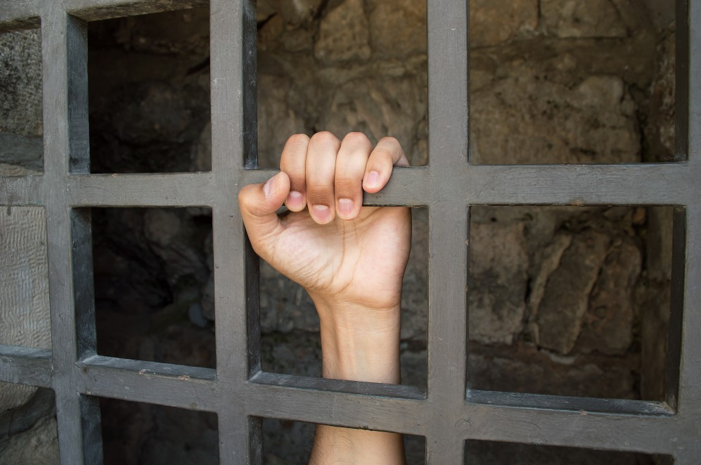 close uo of hand of a prisoner