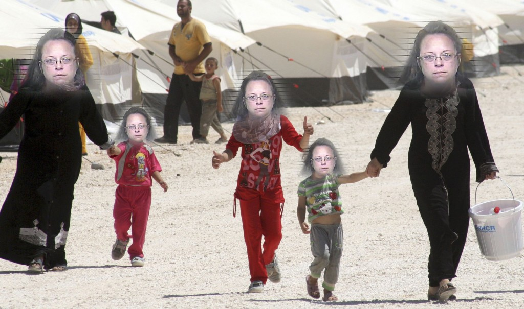 SYRIAN REFUGEES WALK THROUGH CAMP IN JORDAN
