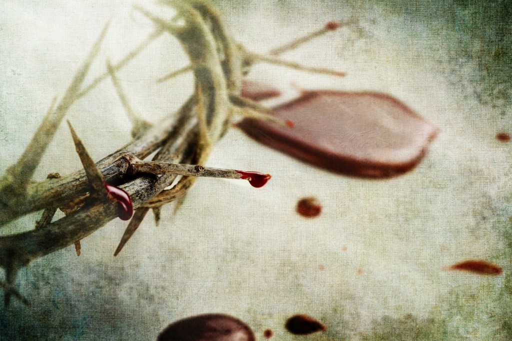 Crown of thorns with drops of blood over grunged background.
