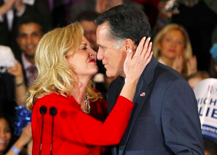 (Photo: REUTERS/Mark Blinch) Mitt Romney gets a kiss from his wife Ann after she introduced him to speak to supporters at his Michigan primary night rally in Novi, Michigan, February 28, 2012.
