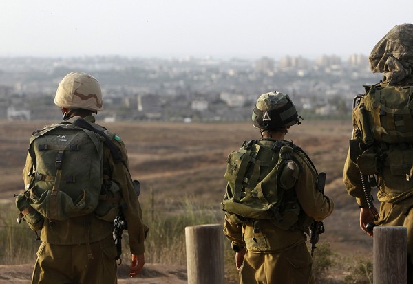 Israeli soldiers patrol near the border with the Gaza Strip