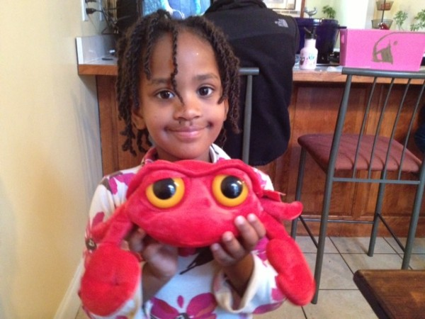 "Naomi loves her gift, which she calls her ""clobster.""  (Even though it's a crab.)"