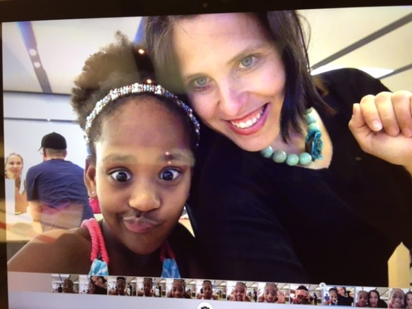 "At the mall at the Apple store, when Naomi found a ""photo booth"" function on a new desktop."