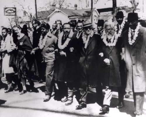 An iconic image of Martin Luther King Jr., a Baptist preacher, and Abraham Joshua Heschel, an Orthodox rabbi, marching together.