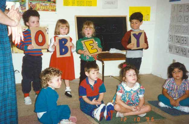 Rachael (bottom row, second from right) and her fellow homeschooled friends know to obey!