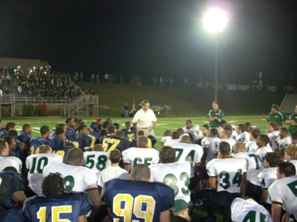 "FCA's caption: ""William Fleming and Northside football teams meeting in the middle of the field to hear about Jesus and pray"" (Image via Facebook)"
