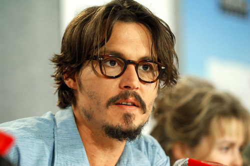 Actor Johnny Depp , known for his roles in Pirates of the Caribbean ... Johnny Depp