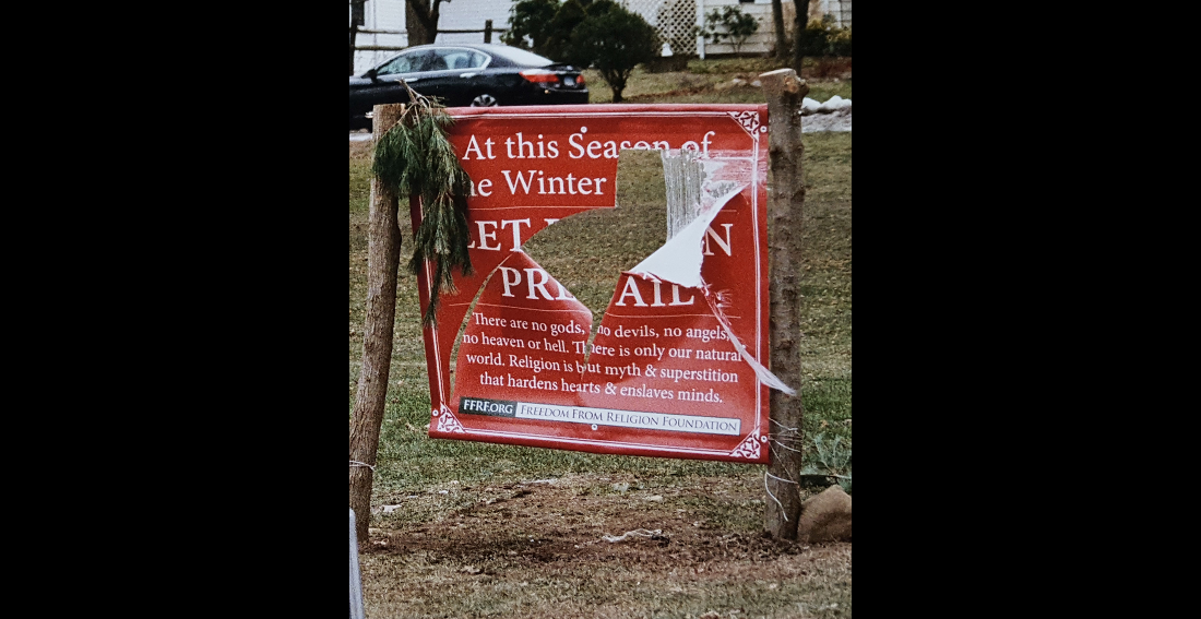 "Here's What an Atheist's ""Let Reason Prevail"" Banner Looks Like After It's Been Slashed Up"