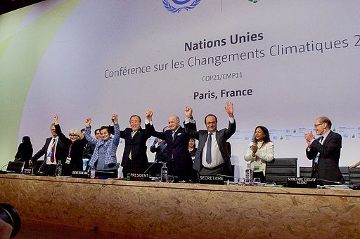French_Foreign_Minister,_UN_Secretary-General_Ban,_and_French_President_Hollande_Raise_Their_Hands_After_Representatives_of_196_Countries_Approved_a_Sweeping_Environmental_Agreement_at_COP21_in_Paris_(23076185424)