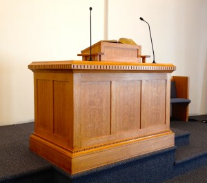 My pulpit, designed by moi and custom made by a master furniture maker in my congregation from hand-selected quarter-sawn red oak.