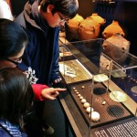 exhibits_dead-sea-scrolls_family-pointing-scales-weights