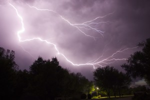 Lightning storm over dark neighborhood
