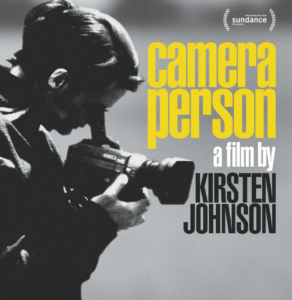 "image of a woman with her eye to a camera. to the right of her head are the words ""camera person: a film by kirsten johnson"" in yellow, white, and black narrow block type."