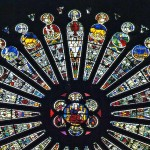 The Saint Maurice Cathedral of Angers, South Rose Window of Christ, each stained glass transept on the top half of the rosette, represents the 12 signs of the Zodiac. Designed by Andre Robin.