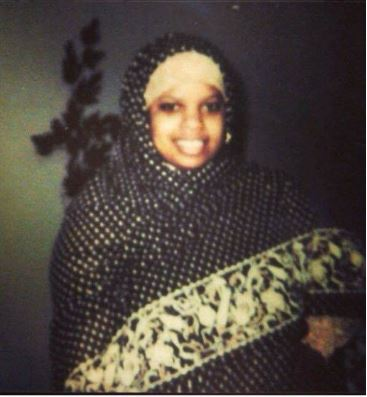 Sister Wadiah P. Jones tries on a Sudanese tobe, 1982 Credit: Wadiah P. Jones