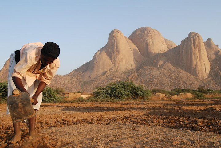 A farmer in front of Kassala's Taka Mountains. Credit: Mohamed Siddig
