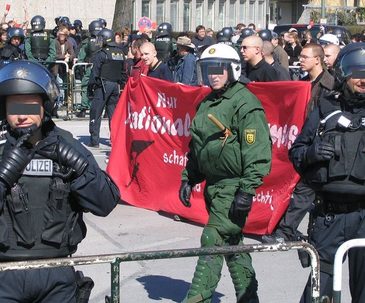 A Munich Neonazi demonstration, from Wikipedia, https://upload.wikimedia.org/wikipedia/commons/b/be/Neonazi_2.4.2005_M%C3%BCnchen_2.jpg