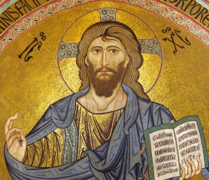 (A mosaic of Christ Pantokrator from the Cathedral of Cefalù. Photo by Andreas Wahra. Source: Wikimedia, Labelled for Reuse).